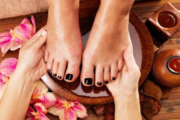 Massage of woman's foot in spa salon
